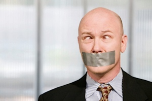duct tape over businessman's mouth
